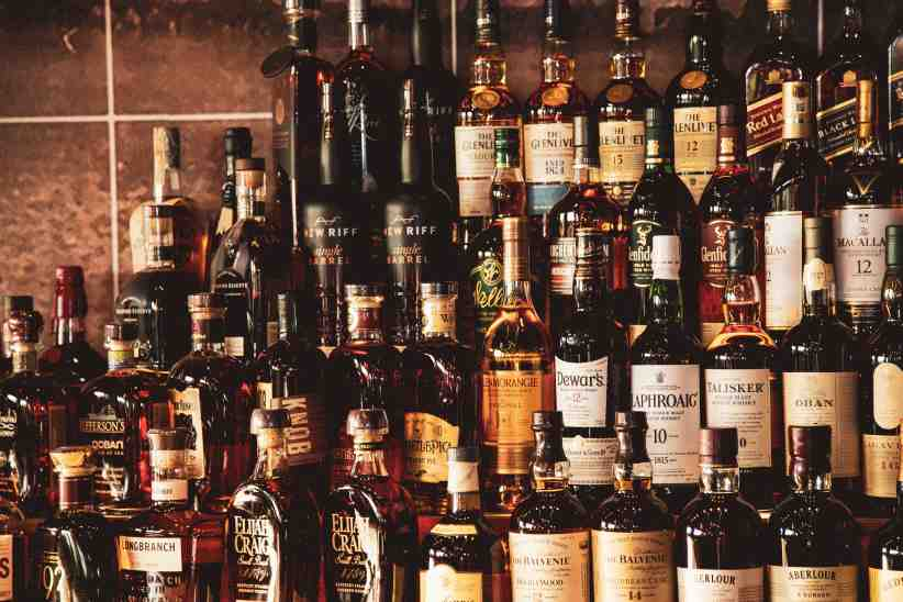 Whiskey bottles behind the bar